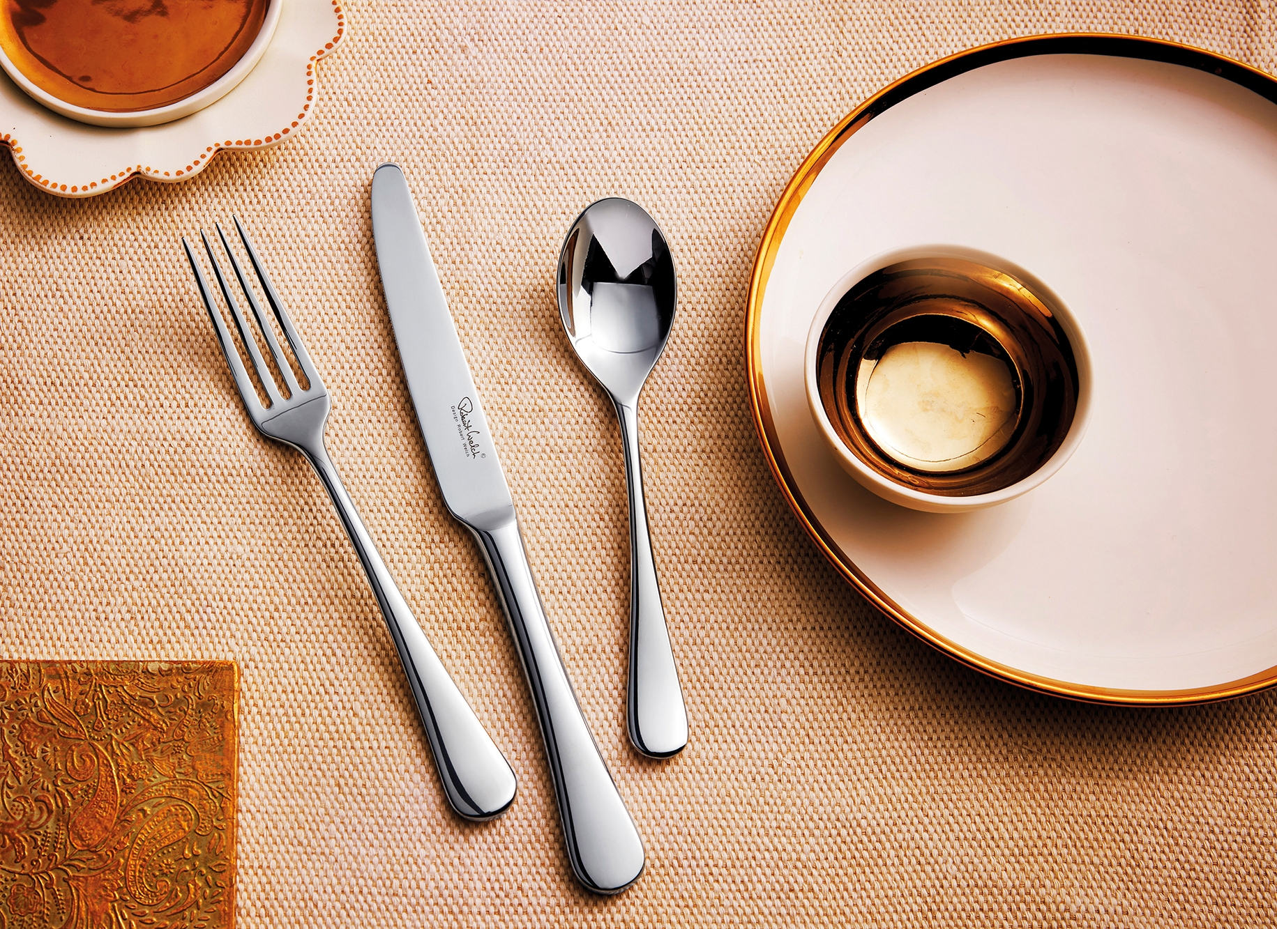 photo of forks and knives at a table