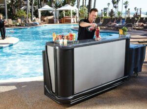 Man serving drinks by the pool
